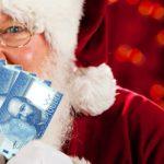 Santa Peeking Over Money Fan